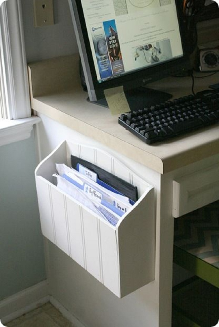 Wooden paper holder screwed to a side of a desk