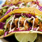 Honey-Lime-Tequila-Shrimp-Tacos-with-Avocado-Purple-Slaw-and-Chipotle-Crema-150x150