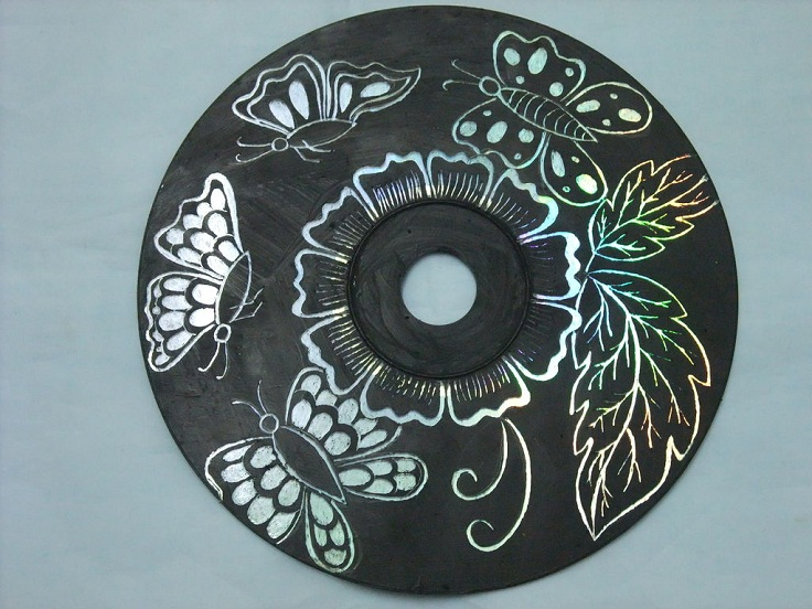 By-painting-a-CD-black-and-etching-out-a-pattern-you-can-make-beautiful-wall-art.
