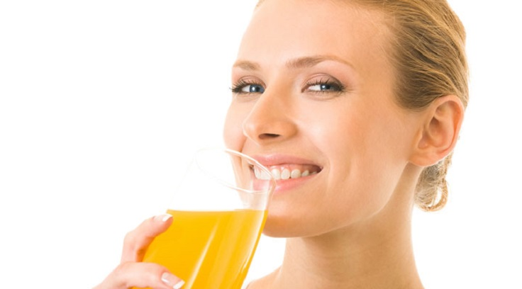 woman-drinking-orange-juice