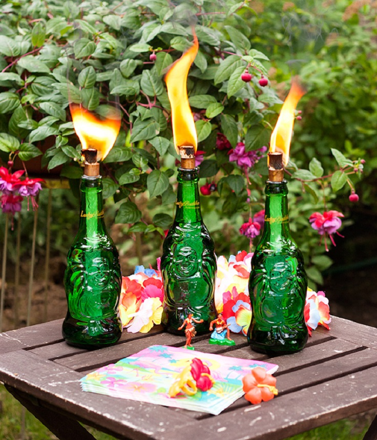 Top 10 backyards diys you must do this summer top inspired for Diy beer bottle tiki torches
