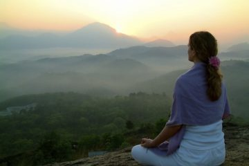 topMeditation-ebooks-woman-meditating-peacefully