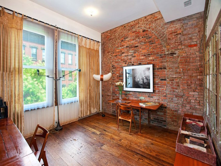 topastounding-home-interior-design-ideas-with-exposed-red-brick-wall-accent-added-with-wall-mounted-flat-television-on-laminate-parquet-flooring-plan