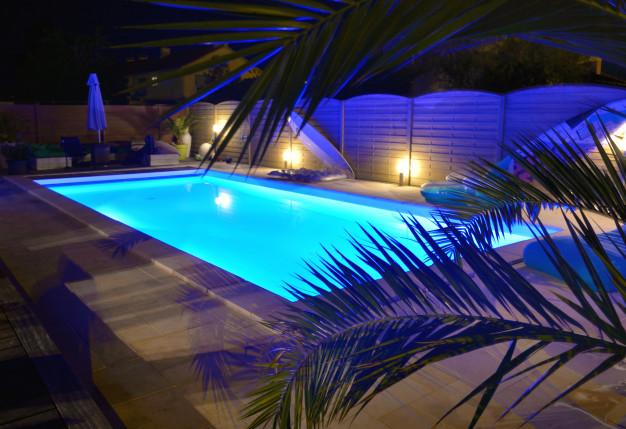 swimming-pool-illuminated-blue-by-night